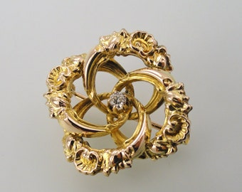 Scrolls and Swirls in an Eternal Knot, 10k Yellow Gold and Diamond Brooch-Pendant, Circa 1900. (A1363)