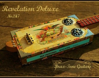 Revelation cigar box slide guitar