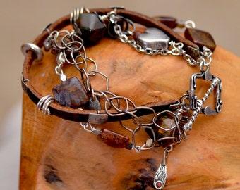Ammolite Leather Bracelet. Oxidized Silver Bracelet.  Rustic Silver Heart Bracelet. Silversmith. Charm Bracelet. Multi strand Bracelet.