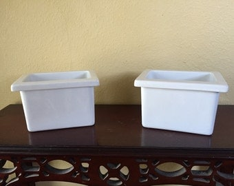Pair of white square planters marked Brunswwick