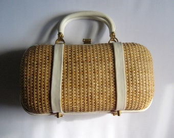 25 per cent off. Use coupon code HOLIDAYHAPPINESS2.Adorable 1950s rattan and vinyl purse. Made in Hong Kong. Mid Century handbag.