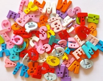 50 pcs Assorted A B C Letter buttons 2 holes for sewing crafts mix color