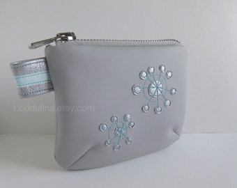 Vegan leather pouch in dove grey, silver and turquoise with chunky metallic zipper and embroidery