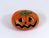Halloween pumkin, hand painted on a stone
