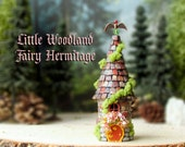Woodland Fairy Hermitage of The Bewildering Pine - Miniature Round Cottage with Mossy Tile Roof, Fairy Door and Blooming Flower Box