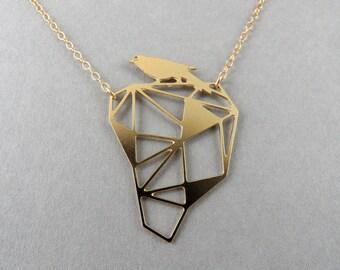 bird necklace, bird on a rock, geometric bird necklace, geometric jewelry