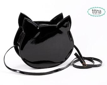 black faux patent leather no face cat bag cross body bag