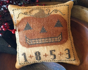 Happy Jack, finished primitive cross stitched pillow tuck