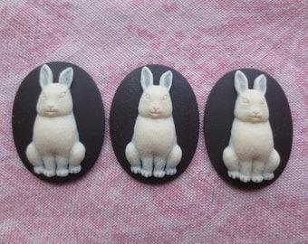 Beautiful black and white tone plastic rabbit design cameos.  Lot of 3 cameos.
