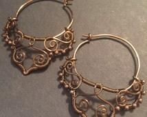 Antique brass wire wrapped filigree hoop earrings .#25