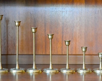 vintage graduated solid brass candle stick holders