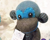 North the Grey Sock Monkey with a Blue Snowflake Sweater Plush Toy