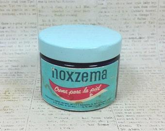 NOXZEMA JAR with Label in Spanish, Original Light Blue Lid, Vintage Cobalt Blue Glass