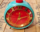 Vintage alarm clock Jantar from Soviet Union era turquoise color clock