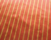 Fabric by the yard,  silk in dark red with gold stripes, one yard.