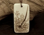 Natural, earthy porcelain pendant with an impression of Queen Anne's Lace