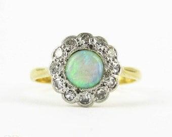 Vintage 1930s Opal & Diamond Ring, Cabochon Cut Opal with Diamond Halo. Art Deco, 18 Carat Gold and Platinum.