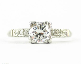 Vintage Diamond Engagement Ring, Round Brilliant Diamond in Mid Century Fishtail Platinum Setting. Circa 1940s, 0.56 ctw.