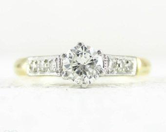 Vintage Diamond Solitaire Engagement Ring. Round Brilliant Cut Diamond Set in Classic Late Art Deco Setting, 18 Carat Gold & Platinum.