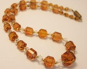Vintage Art Deco necklace. Golden brown glass bead necklace.