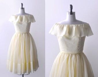 50 light yellow dress. organza. 50's yellow party dress. sheer. sleeveless. collar. full skirt. xxs.