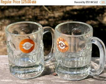 A Set of 2 Early 1960s A and W Medium Sized Mugs With the Arrow Logo