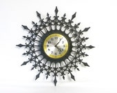 Vintage 1960s/70s Mediterranean Black Molded Plastic Wall Clock/New Haven Clock