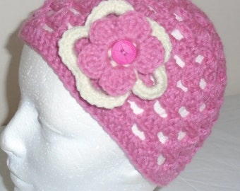 "Crocheted spring pink beanie with flowers, fits head size small, 21 to 23"" around."