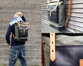 Waxed canvas rucksack / backpack with roll up top and oiled leather bottem