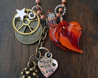 Hand blown borosilicate glass heart and charms necklace with copper chain & toggle clasp.