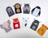 custom order for ulrike jaeger: a penguin, a hippo, a bear, a rhino, and a walrus finger puppet