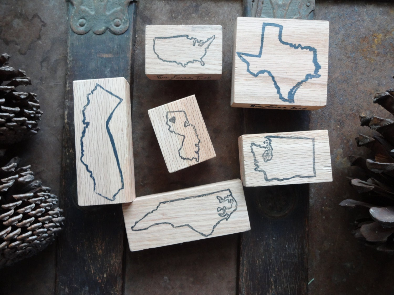 Hand carved outline location stamp america international