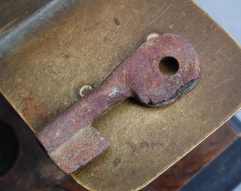 Antique little brass skeleton key. original dark patina