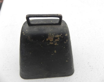 Very old cow bell....black with gold spots showing through