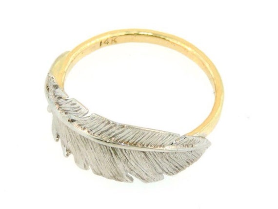 14k white gold feather ring on a handmade 14k yellow gold band