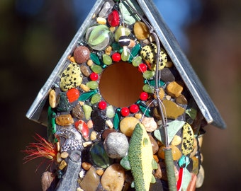 The fisherman Mosaic Birdhouse for the Nature lover featuring fishing lures,weights,river rocks,colorful stones for the outdoor bird watcher