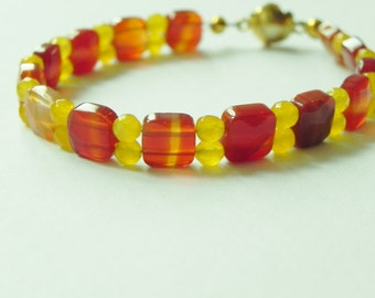 Red agate and yellow jade gemstone bracelet with gold plated magnetic flower clasp.