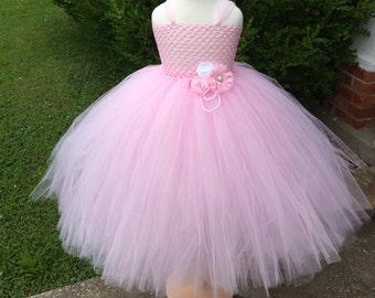 Light pink chic couture flower girl dress perfect for birthdays, photo opps, weddings and much more