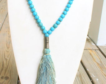 Vintage African Glass Blue Trade Bead Necklace with Fabric Tassel and Brass Accents