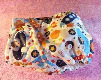 SassyCloth one size pocket diaper with astronaut adventure PUL print. Made to order.