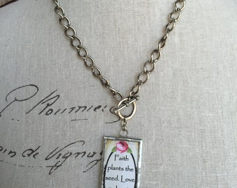 Pendant necklace in antique silver toggle clasp chain.