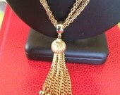 Fritter with this vintage textured gold tone metal tassel necklace