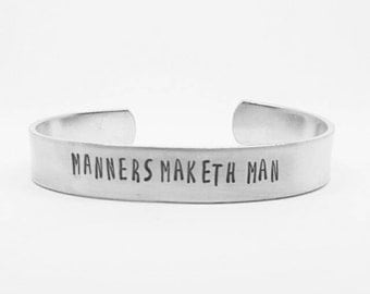 MANNERS MAKETH MAN: hand stamped aluminum Kingsman quote cuff bracelet