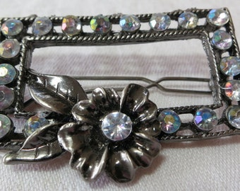 """Lovely AB rhinestones and metal hair slide, clip. 2""""X1"""" ins, strong working clasp. Pretty metal flower, AB central stone. VI16.3-28-11."""