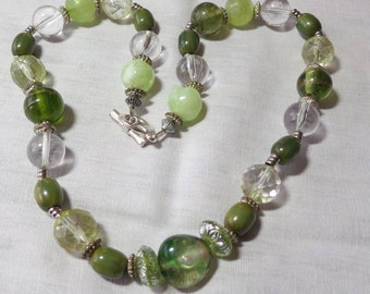 """Lovely green glass bead necklace, some clear stones, some etches, metal separators, 20"""" inches long, drop through clasp. HM14.11-15.11-15,"""