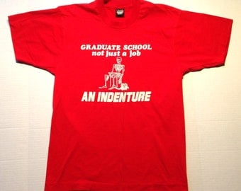 Funny late 80's, early 90's graduate school t-shirt, fits like a medium