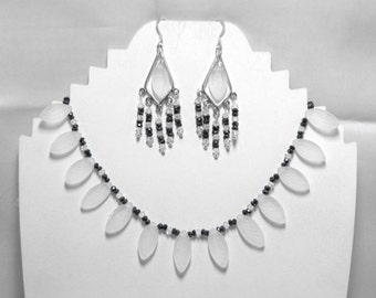 Carved quartz crystal, black spinnel, Swarovski crystal and sterling silver