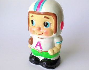 """Vintage Ceramic Football Player Coin Bank, """"A"""" Monogram on Jersey, Japan"""