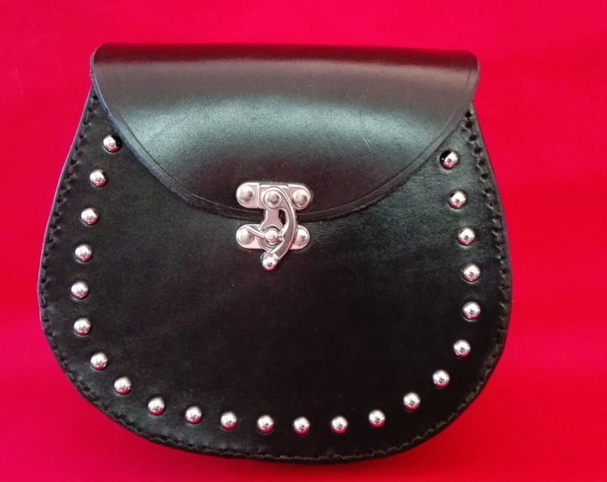 leather sporran with concealed hand gun holster, leather waist bag with nickel domes, custom made leather sporran,fanny packs,hip bags