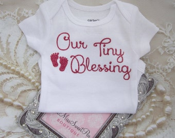Our Girl's Tiny Blessing Bodysuit. Vinyl letters on White a Carter's one piece. Buy ONE for a baby shower gift. By Lil Miss Sweet Pea